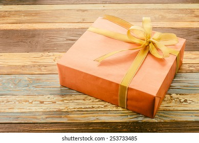 Gift box on wooden background - vintage effect
