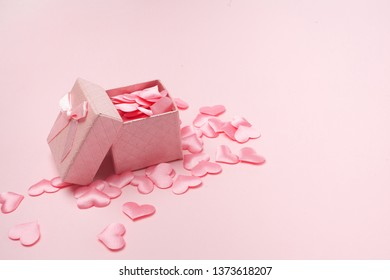 gift box open heart floating on pink background, love greeting concept