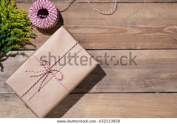 Gift box over wooden background. View from above