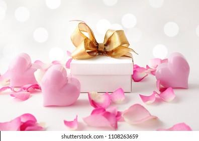 gift box, pink hearts  and rose petals