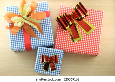 Gift box is placed on wooden floor in concept of Christmas and New Year.