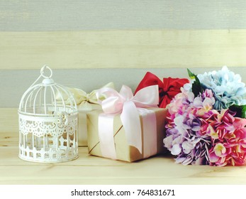 gift box present with flower and bird cage decoration