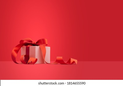 Gift box or present box with red ribbon on red background.