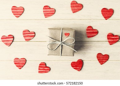 Gift box and red hearts on Valentines day