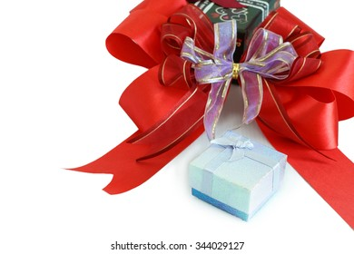 Gift box and red ribbon for greeting season, Gift box background