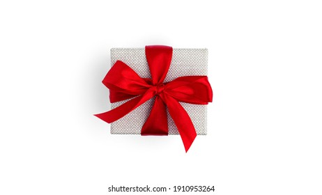 Gift box with red ribbon isolated on white background. High quality photo