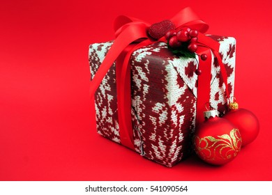 Gift box with red ribbon isolated on red color background. Merry Christmas and Happy New Year