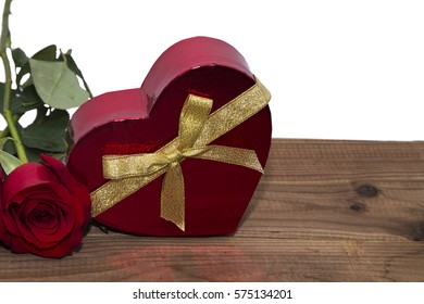 gift box and red roses upon wood