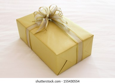gift box with ribbon bow on bed