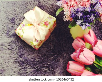 gift box with ribbon and flower bouquet valentine's day background concept