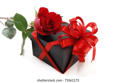 gift box with a rose isolated on white background