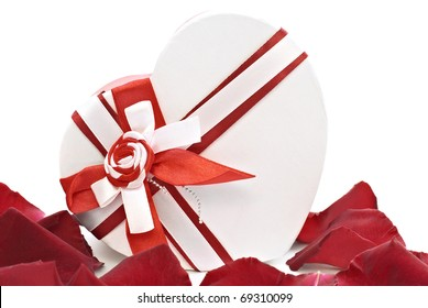 Gift box in shape heart with petals of roses on a white background