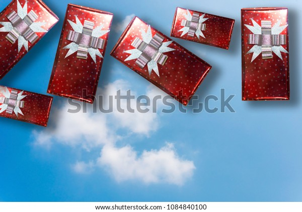 Gift box tied Boca float on the sky background.
