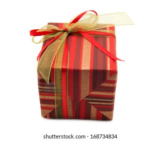 Gift box tied with a gold ribbon bow on white background.