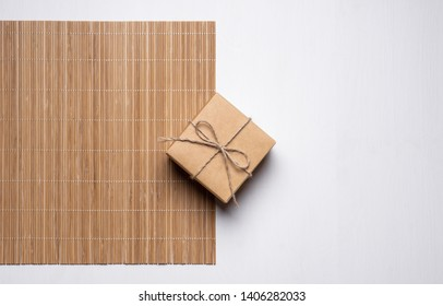 gift box tied with twine on a bamboo mat. gift card concept