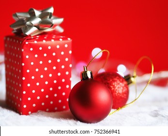 Gift box with toy decoration on red background,Christmas background concept.