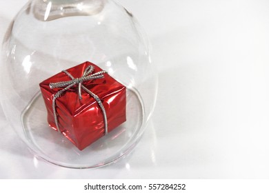 Gift box under a glass