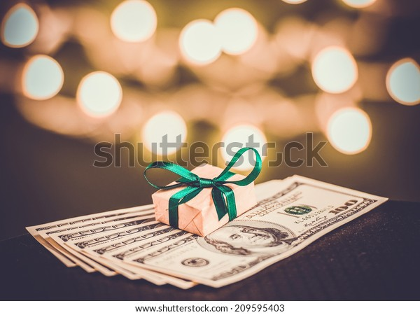 Gift box and US dollar bills. Toned picture