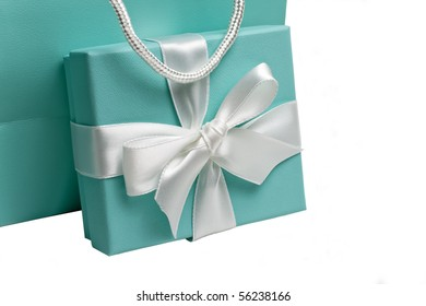 Gift box with white bow and gift bag on white background