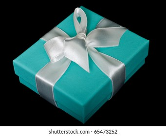 Gift box with white bow on black background