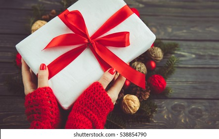 Gift box in woman hands. Holidays present for friends and relatives.