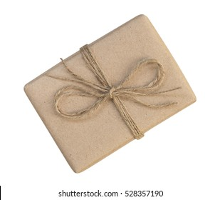 Gift box wrapped in brown recycled paper and tied sack rope top view isolated on white background, clipping path included