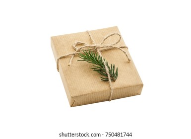 Gift box wrapped in brown recycled paper and tied sack rope top view isolated on white background, clipping path included.  present
