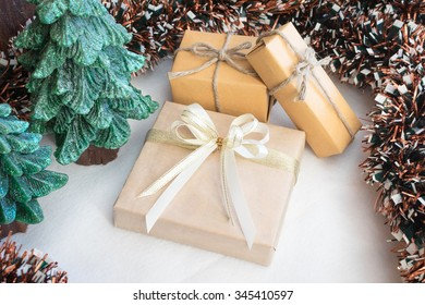 Gift box wrapped in recycled paper with ribbon
