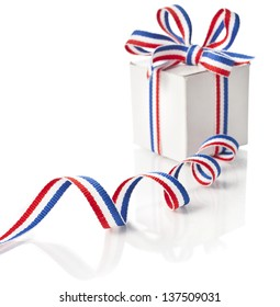 gift box wrapped striped red blue ribbon tape isolated on white background
