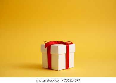 Gift box with yellow background.