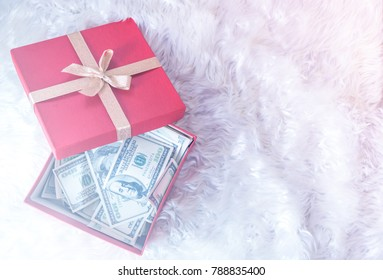 Gift boxes with  the american currency ,dollars bills on white background .Holiday bonus for business concept