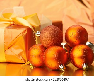 Gift boxes with balls on a christmas background
