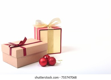 Gift boxes with bow and christmas ball on wood background