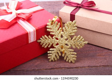 Gift boxes with bow and christmas decoration on wood background