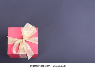 Gift boxes with bow on black background.