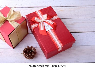 Gift boxes with bow on wood background. Christmas Decoration