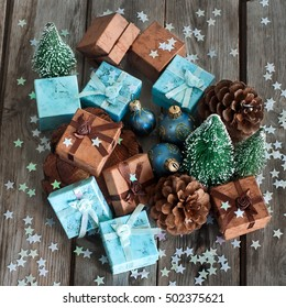 Gift boxes with christmas decoration on wooden table