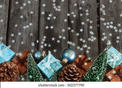 Gift boxes with christmas decoration on wooden table. Copyspace background.