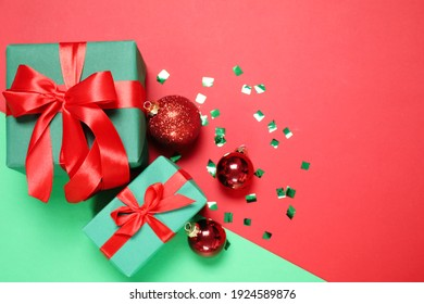 Gift boxes and Christmas decorations on color background, flat lay. Space for text