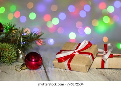 Gift boxes and colorful decorated Christmas tree on bokeh background with copy space.