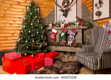 Gift boxes, decorated christmas tree and fireplace
