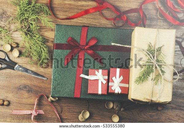 gift boxes and decoration items on wooden table