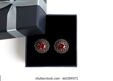 gift boxes for jewelry on a white background. top view. gift concept. Earrings with red stones.