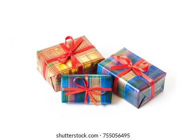 Gift boxes mockup in colorful wrapping paper tied with red ribbons, packages, holidays presents