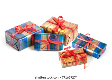 Gift boxes mockup, packaging in colorful wrapping paper tied with red ribbons