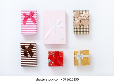 Gift boxes on white background top view. Wedding invitation, greeting card for Mother's Day. Beautiful birthday invitation. Selective focus.