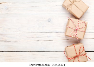Gift boxes on white wooden table background with copy space