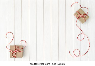 Gift boxes on white wooden background. Christmas holidays composition