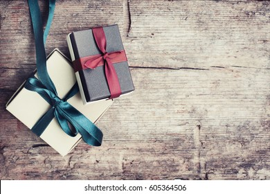 Gift boxes on wood background in vintage style
