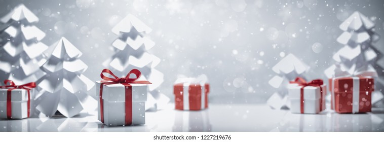 Gift boxes and paper fir tree in snow